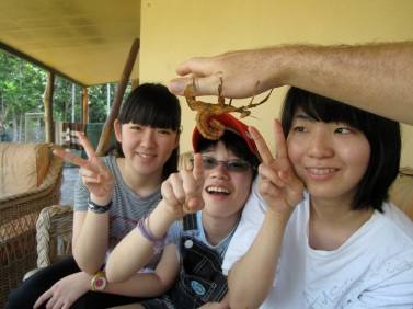 International students meeting a spiny leaf stick insect