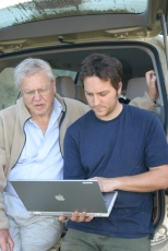 """Sir David and assistant producer, Tim Green going over footage for """"Life in the Undergrowth"""" while on location"""