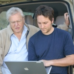 "Sir David and assistant producer, Tim Green going over footage for ""Life in the Undergrowth"" while on location"
