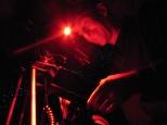 Cameraman Kevin Flay working under red lights to film invertebrates